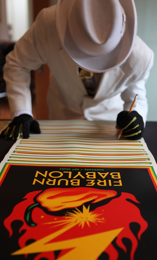 HR signing the 'Fire Burn Babylon' print