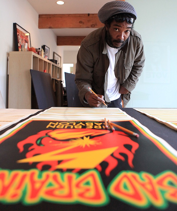 Darryl Jennifer signing Shepard Fairey's prints