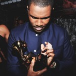 Frank Ocean holds one of his two GRAMMYs